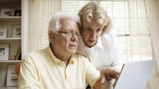 Senior retired couple with laptop